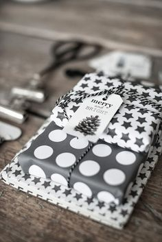 Wrap and stack gifts wrapped in different prints in the same color-  Fairy Nuf #giftwrap #blackwhite