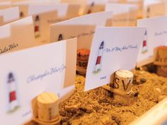 Place cards feature an illustration of Montauk Lighthouse in sand box.. Look sister for your wedding, SOMEDAY! @Magalis Echenique