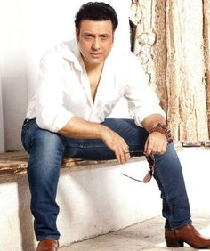 """Bollywood actor Govinda, who has not just acted in and produced his upcoming film """"Aa Gaya Hero"""", but has also written its story. He says turning writer was a situational decision for him. Bollywood Stars, Bollywood News, Bollywood Fashion, Actor Govinda, Handsome Celebrities, Boy Photography Poses, Indian Man, Yesterday And Today, Bollywood Celebrities"""