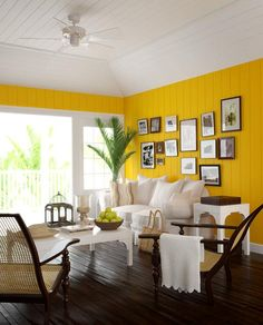 warm and cozy >> Love the yellow wall with white on top.