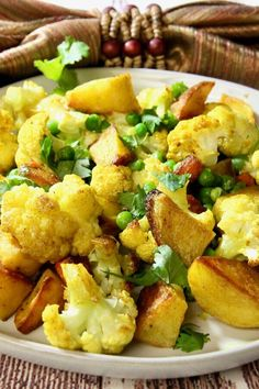 "Sheet Pan Aloo Gobi | ""I had half a head of cauliflower in the fridge and wanted to try something new with it. We love curry, so that was the motivation to make this recipe which I scaled down to 3 servings."" #easy #easyrecipes #quickandeasy #easyrecipesideas #dinner #supper #sheetpandinner #easydinnerideas #sheetpansupper #easysupperideas Quick Supper Ideas, Madras Curry, Aloo Gobi, Sheet Pan Suppers, Indian Food Recipes, Ethnic Recipes, Frozen Peas, Food Reviews"