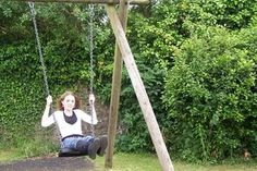 How to Set Wooden Poles for an Adult Swing   eHow