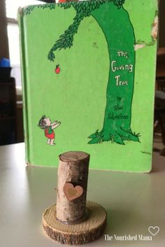 A cute wooden craft activity to go with the children's book The Giving Tree by Shel Silverstein using birch wood rounds and branches.