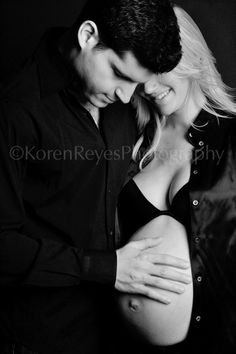 LOVE THAT! - black and white photo of pregnant woman and her husband