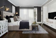 hamptons-style-master-bedroom-with-tufted-headboard-and-dark-floor