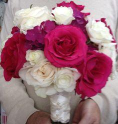 Hot roses, white roses, and purple hydrangeas