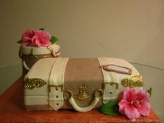 A luggage cake and Hatbox for a bridal shower. The couple are going to Hawaii on their honeymoon, so gumpaste Hibiscus to go with the theme.