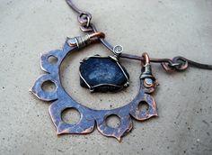 http://silviapeluso.files.wordpress.com/2013/01/dark-lotus-with-green-tourmaline-02.jpg