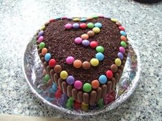 I like the chocolate fingers idea & smarties - but square and with a chocolate buttercream topping