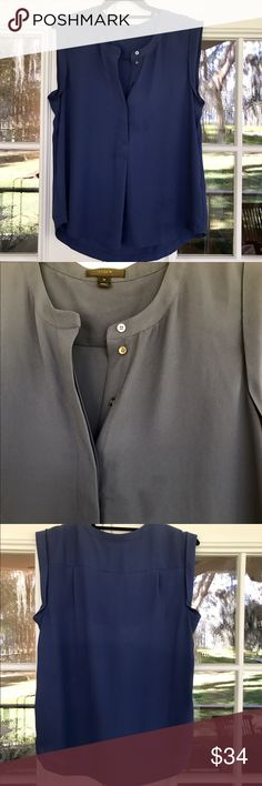 J.crew sleeveless drapey popover shirt Blue , sz12 J.crew sleeveless drapey popover shirt -, light navy blue , sz 12 This is another great closet staple shirt , gorgeous drape that looks great tucked in or out and dressed up or down - it's a Silk like fabric that can also be washed vs dry cleaned! The blue is in great condition with one small stain that will easily come out & shown in the second picture, it's harder to see so I lightened the color a bit to show -  I have this top in multiple…