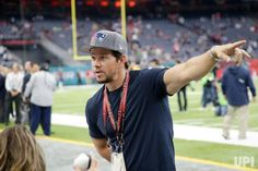 Actor Mark Wahlberg Mark Wahlberg talks to fans before the start of Super Bowl LI between the New England Patriots and the Atlanta Falcons…