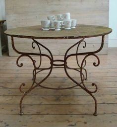 French Round iron table with pretty base