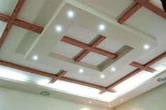 ceiling design ideas | modern false ceiling design for living room from wood and gypsum with ...