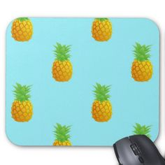 Pineapple Pattern on Blue Mouse Pads. A repetitive pattern of simple pineapples on a bright blue background. This is a cute and summery pattern perfect for many occasions.