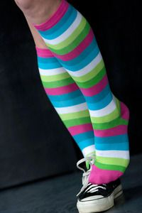 A bunch of bold colors working together to make your legs rock in either warm tones or bright ones with very good stretch and stay-up power in these knee high Sock It To Me striped socks.
