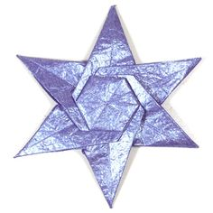 How to make a CB six-pointed seashell origami star (http://www.origami-make.org/origami-star-cb-seashell-six-pointed.php)