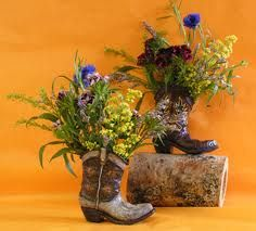 OBSESSED: i saw an old cowboy boot being used as a vase at a farmer's market. so unique.