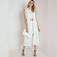 Longline sleeveless long blazer vest ivory white Nwt!! Too big for me :/ so chic sz UK 4 or us 2 so listing as a 2. Great summer blazer for work. Wish it fit me. Blogger favorite Missguided Jackets & Coats Blazers