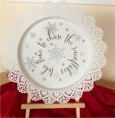 candle plate with vinyl snowflakes Sign up for our monthly craft idea:  http://www.wordplaydesigns.net/#!wp-newsletter/c1zmd
