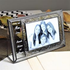 Remember mom or grandma with a personalized frame. Unique in it's style and quality this stained glass picture frame has a clear glass panel to the left of the photo that can be personalized with 5 lines. Personalize yours at UnchartedVisions.com