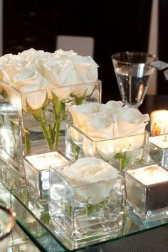 This is for the 10 round guest tables...We like the idea of the glass and candles. Flowers are a possibility and would be awesome, as long as they are not too expensive.: #adornosflorales