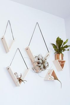 Set of 5 Handmade Triangle Shelves Stunning set of 5 solid pine shelves handmade by Mezcla Designs. Each shelf is hung with leather lace, with the color of your choice: black or cognac. These are perfect for displaying your small potted plants and air pla Pine Shelves, Diy Hanging Shelves, Black Shelves, Decorative Wall Shelves, Floating Shelves, Plants On Shelves, Diy Wall Shelves, Shelving Ideas, Small Shelves