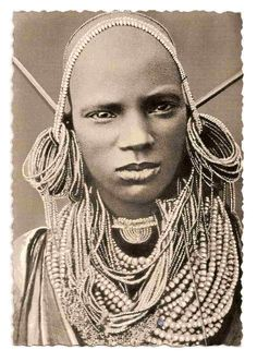 Kenya - Kikuyu People - Kikuyu Girl, 1950s. The Kikuyu are the largest ethnic group in Kenya. They speak the Bantu Kikuyu language as a mother tongue. The term Kikuyu is the Swahili form of the native pronunciation Gĩkũyũ. Group members refer to themselves as the Agĩkũyũ. Gĩkũyũ literally means a huge sycamore tree and Agĩkũyũ thus literally refers to the children of the huge sycamore. https://en.wikipedia.org/wiki/Kikuyu_people