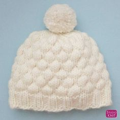 Super cozy! Make this pretty Textured Bubble Hat in wool roving yarn with Studio Knit Free Pattern and Video Tutorial. #StudioKnit #bubblehat #knithat #howtoknitahat #freepattern #knittingpattern