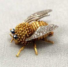 Gold and diamond bee pin