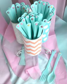 These DIY pearled plastic forks and spoons are perfect for a first birthday mermaid party!