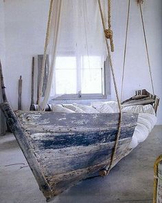 """They call this a """"boat bed"""" in the article, but I really want to make something like this for a large covered porch or screened porch and use it as a couch/daybed/hammock. Love it!"""