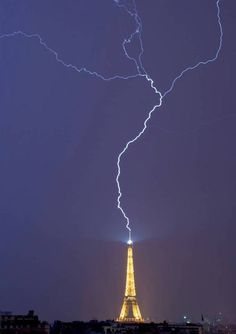 """Reverse Lightning: """"The upward branching in this photo shows that the Eiffel Tower actually initiated the discharge,"""" says lightning researcher Richard Blakeslee of NASA. """"...Instead of starting in the cloud..., this flash started when the tower 'launched' a leader that [went] upward toward the cloud [and] it branched out. Eventually one of the branches reached a region of sufficient charge to 'short out the cloud' and produce the return stroke pictured above.""""      - photo by Hakim Atek"""