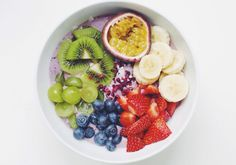 I like my breakfast the color of the rainbow!  Skyr/greek yoghurt blended with a handful blueberries, a tablespoon acai powder and a little stevia + topped with raw coconut shavings, freeze dried blackberry, sliced banana, chopped strawberries, blueberries, grapes, kiwi and passionfruit. I als....