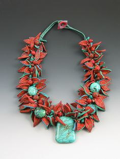 Finger woven polymer clay leaves, turquoise and copper by Janet Farris