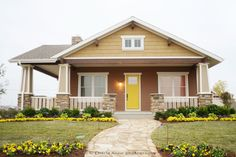 Love this house!  Yellow door and flowers!  It was also part of Extreme Home Makeover.
