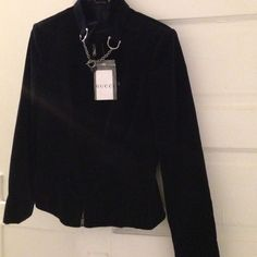 NWT Dark blue velour w/elastic waist length jacket Belted neck line with horse it silver closure. Zips up the front with signature zipper hooks. I'd label inside jacket. Very pretty & stylishly so like a sz 6-8blow out sale Gucci Jackets & Coats