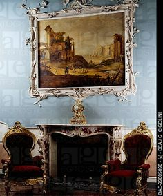 Pink marble fireplace in Louis XV style, Palazzo Costa, Piacenza, Emilia-Romagna. Italy, 18th century.