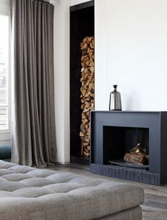 Since I've already decided that my hubby and I's room is going to be black, white, gray with an accent color. this fireplace and wood storage will be PERFECT for our room. Though, I'll be needing a bigger fireplace Curtains Living Room, Home Fireplace, Home, House Design, Fireplace Design, Contemporary Fireplace, Interior Design, Fireplace Surrounds, House Interior