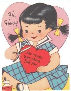 Girl cuts a paper heart as she makes a Valentine  - vintage Valentine