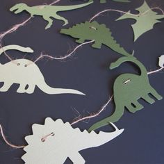 Dinosaur garland. I should make this! Cute.