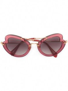 47615a1e46b1 Shop Miu Miu Eyewear Scenique sunglasses.  MiuMiu Miu Miu
