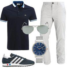 Outfit composto da polo griffata, pantalone monocromo e sneakers basse. Completano il look gli occhiali Ray-Ban e l'orologio analogico resistente all'acqua.