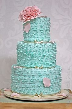 Love the rose accent. It's the perfect color too, just not that ugly cake, but ribbons of that shade of blue.