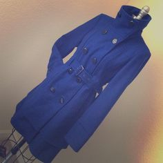 worthing peacoat - blue like new, still has extra button attached to coat (shown in picture). outer shell/exterior - 62% wool, 24% polyester, 14% rayon. lining - 100% polyester Worthington Jackets & Coats