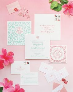 Guests knew to expect a fun, tropical wedding when they received this bright pink and aqua invitation suite, decorated with pineapples and palm trees.