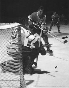 Jean Beliveau and Terry Sawchuk.  Beliveau was a big fluid skating center who stick handled like a man half his size. Beliveau used his size to advantage but was never a dirty player. You can do it, Montreal!