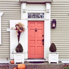 A little pink to brighten your Tuesday. Love this choice in paint color from @devonmpark. This soft coral/salmon/pink door color accents this home beautifully!  Happy Tuesday!