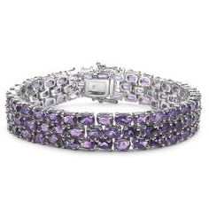 @Overstock - Over 100 oval-cut amethyst gemstones grace this .925 sterling silver bracelet. This amethyst-stacked link bracelet secures with a box clasp.  http://www.overstock.com/Jewelry-Watches/Sterling-Silver-Amethyst-Bracelet/4761185/product.html?CID=214117 $179.99