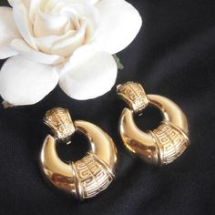 "HPVintage Givenchy Door Knocker Clip Earrings Office Style Host Pick by @poshlawyer 6/13/16Measures about 1 1/2"" long and 1 1/8"" in diameter.  Gold tone with logo.  Signed Givenchy Paris New York.  In nice vintage condition.  Clips are still tight.  No trades or PayPal. Givenchy Jewelry Earrings"