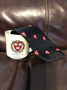 1 small gold/ silver tone trim that is wearing off ring of mug with logo from Harvard Club of Cape Cod. Harvard Club, Strapback Hats, Cape Cod, Silk Ties, Presidents, University, Skinny, Mugs, How To Wear